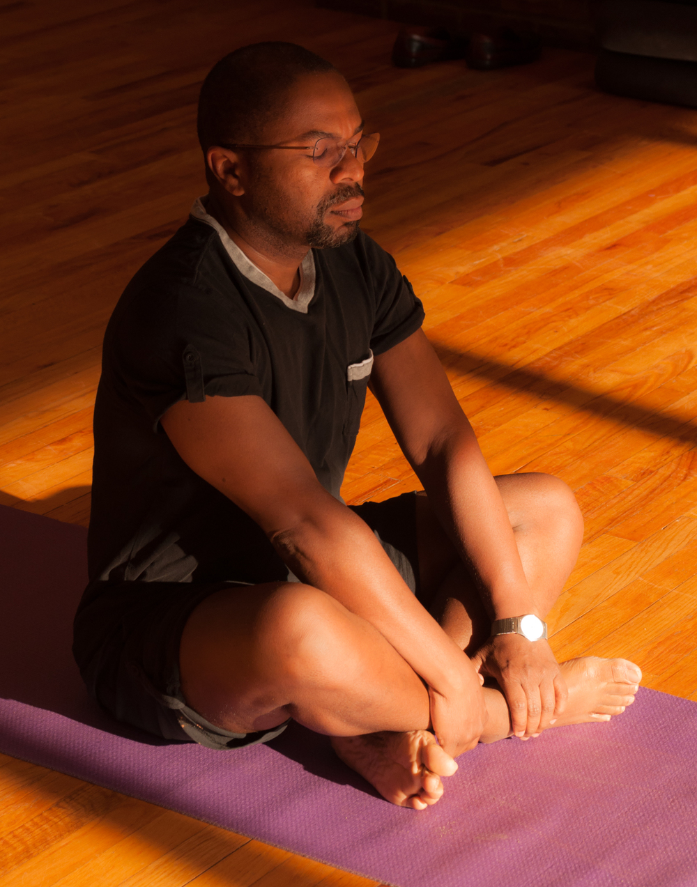 Man meditating on a yoga mat