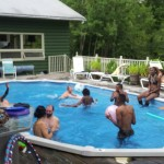 Members of Arts in the Woods in the pool