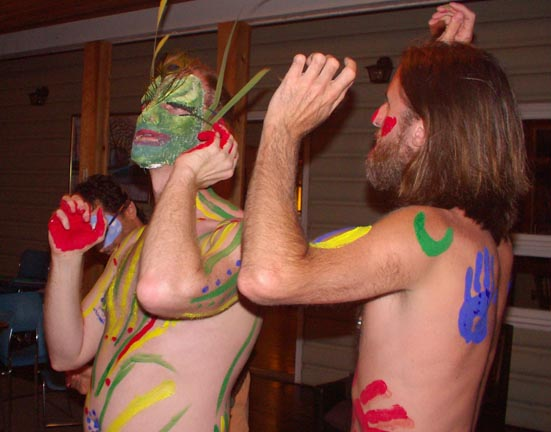 Men dancing in masks and body paint