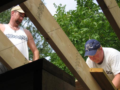 Tracy and assistant working on the roof