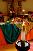 Light candles and altar