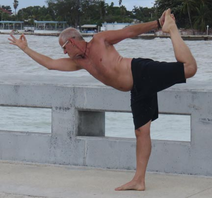 Man in standing yoga pose