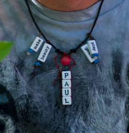 Necklace with beeds that have words on them