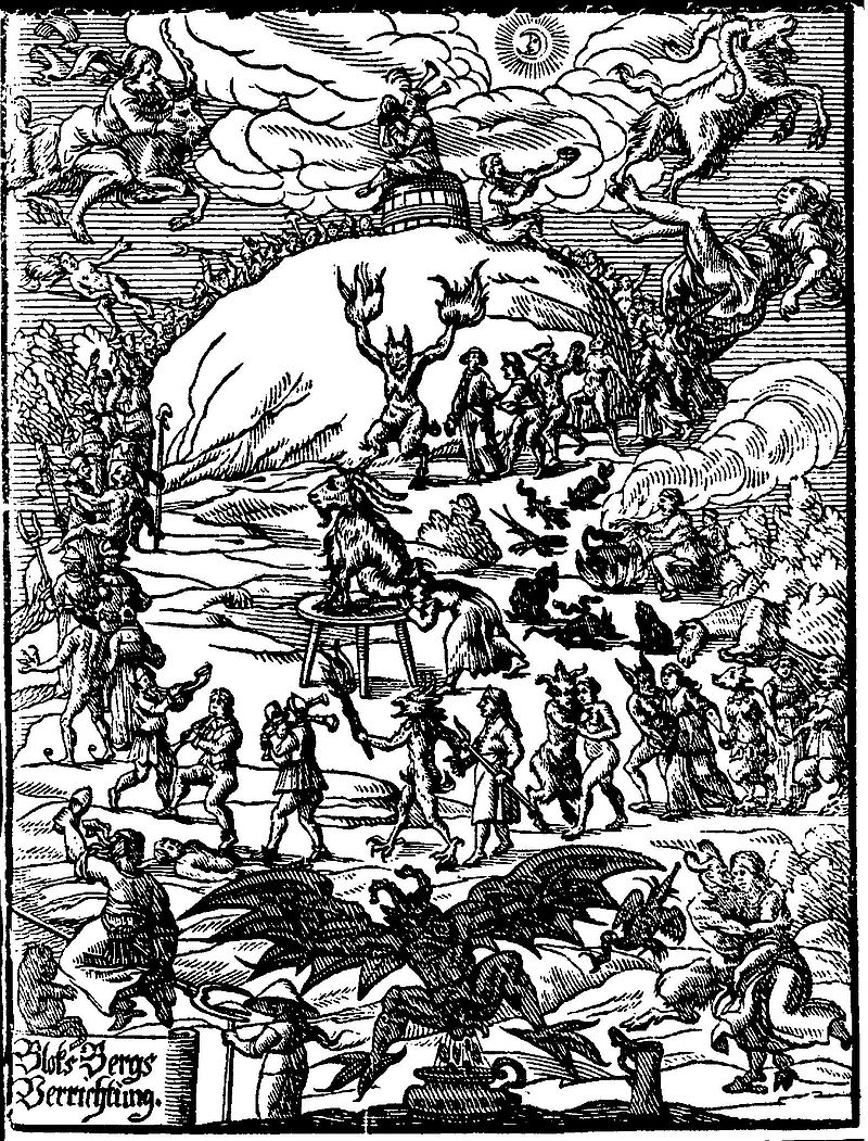 Woodcut of witches dancing around a horned god.