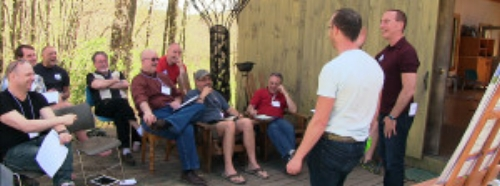 Men outside in a meeting