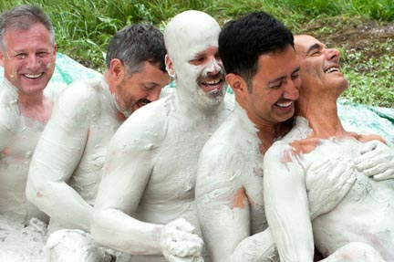 Five mud-covered men