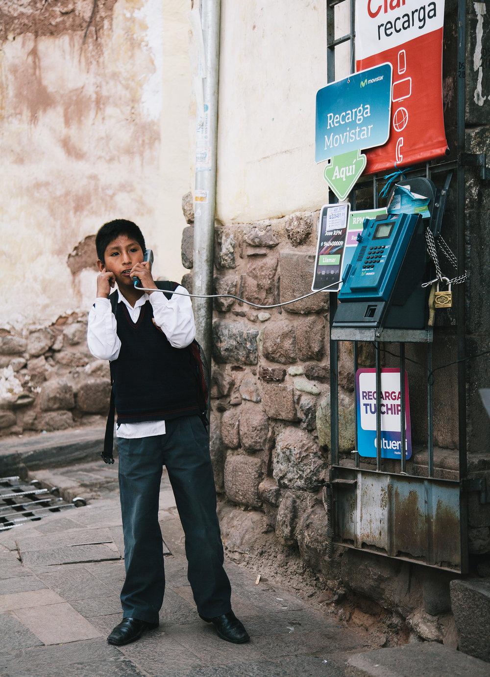T&L_Cusco_BoyOnPhone_IMG_0359.jpg