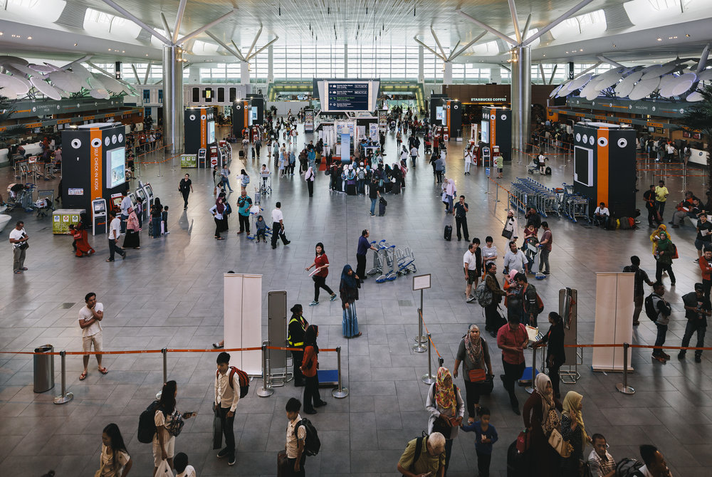 Kuala Lumpur International Airport, where at a check-in kiosk,the assassination was conducted for the world to witness.