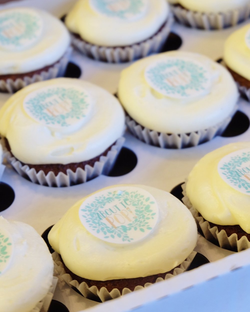bespoke 'about to pop' baby shower cupcakes