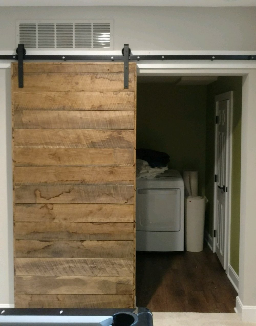 Deminsional horizaontal door with wood frame hanging.jpg