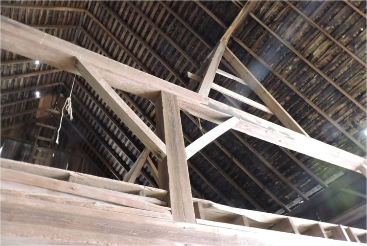 Beams supporting a barn. Oak circle milled beams were used here.