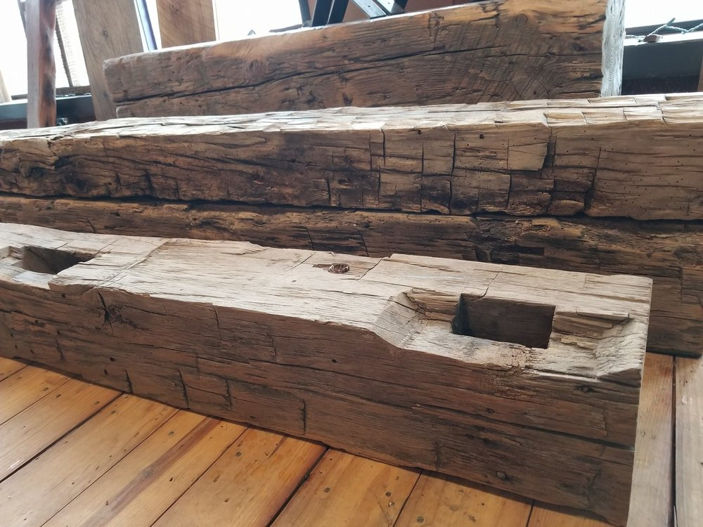 Reclaimed from a dairy barn these 8 x 8 beams are hand-hewn. Some have mortise pockets while others do not.