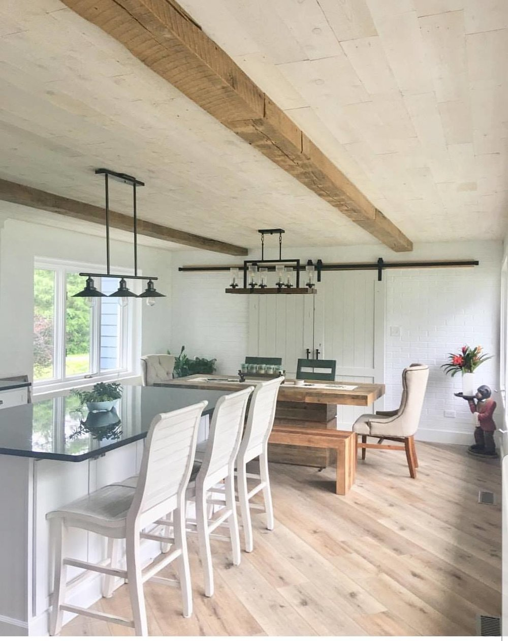 Beauty everywhere. The reclaimed beams on the ceiling and the amazing farm table with a solid 6 x 7 beam base is incredible. I love the thick table top. Lets not forget the sliding doors. The white allows all the natural wood tones to take there moment.  (All custom orders )