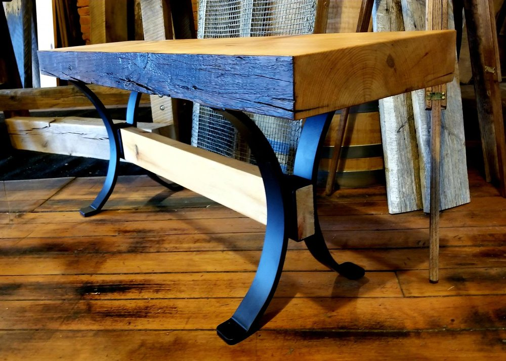 12 inch wide x 4 ft long bench with a trestle base. The solid steel legs are painted black, but could be bronze or raw steel. The 3 inch thickness adds to the rustic look of the white pine as does the natural edge. Follow the link to order.  http://www.reclaimedbarnsandbeams.com/inventory/bench-with-steel-base