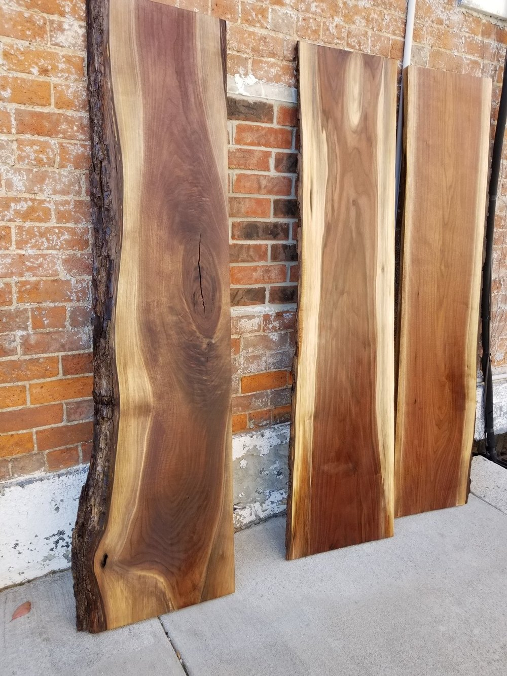 This Black Walnut with the bark will create unique shelving. The natural color tones and variation along with the grain makes this wood stunning.