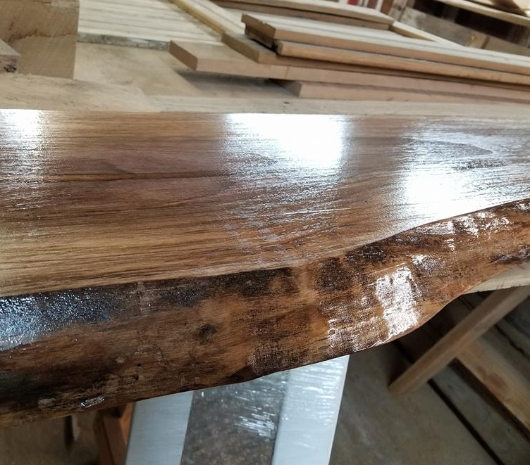 Putting a finish on this black walnut shelf.