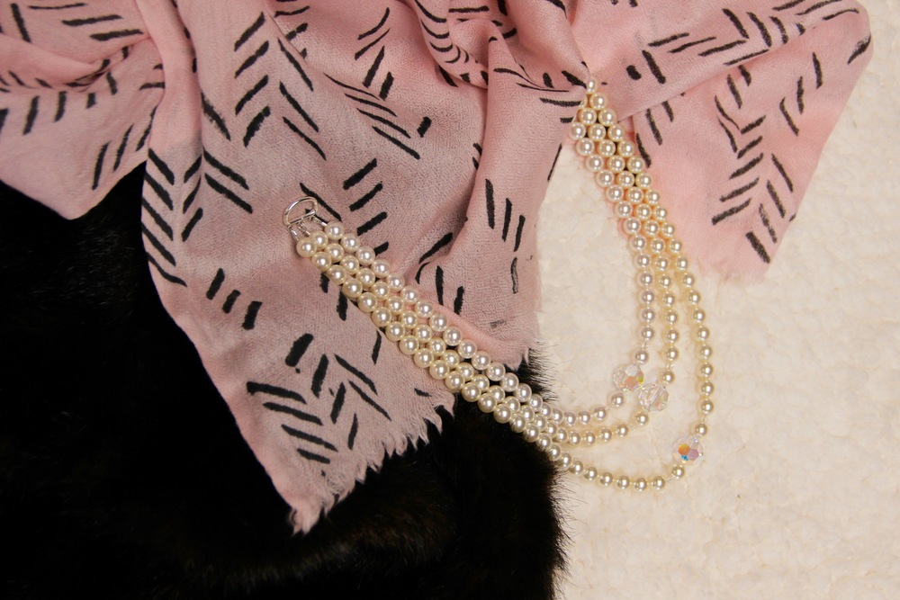 Add holiday sparkle to this rose-colored scarf with a pearl necklace. Faux fur is a toasty plus. Scarf Symbology | necklace Bettina Hehlen Photography and Jewelry