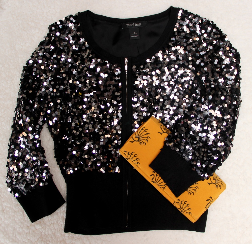 Sparkles are fun, but black and white can get boring – add a pop of color with a vibrant clutch.   Clutch   Symbology |   jacket   White House Black Market