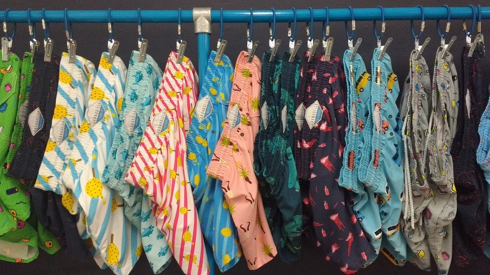 Granadilla's swim trunks are patterned with traditionally South African taxicabs and lollies.