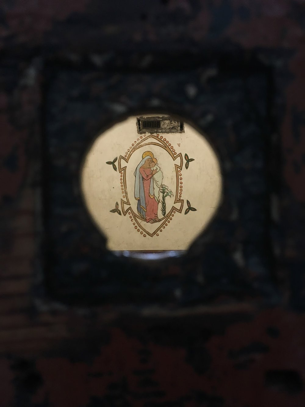 Looking inside the peep-hole of Grace Gifford's old cell, you can see a beautiful painting of the Madonna she created with smuggled paints. Grace Gifford married her fiancé Joseph Plunkett only hours before his execution for his part in the 1916 Easter Rising.