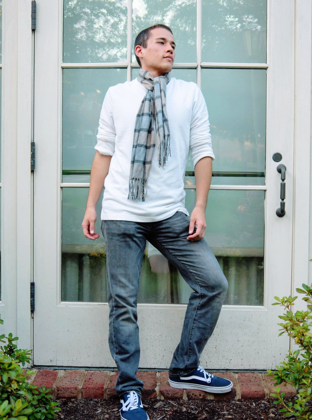 Yuma, junior, wears a white GOODFELLOW shirt   and charcoal-colored LEVIS with a plaid scarf he thrifted.