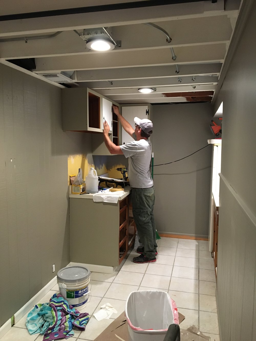 Middle of kitchen renovation. Freshly painted cabinets being installed. All cabinet hardware was cleaned and spray painted for a fresh look.