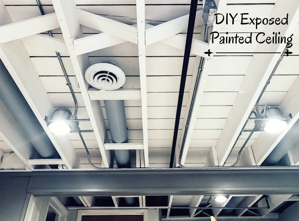 DIY Exposed Painted Basement Ceiling. Tips for how to paint a basement ceiling. This will brighten up your room!