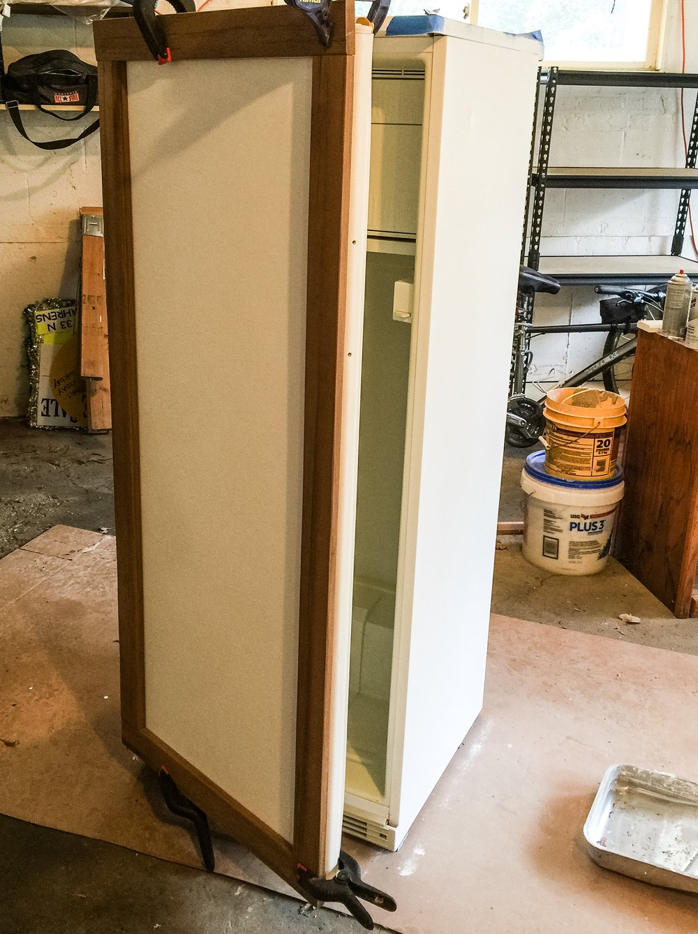 Framing a refrigerator to make a chalk board fridge.