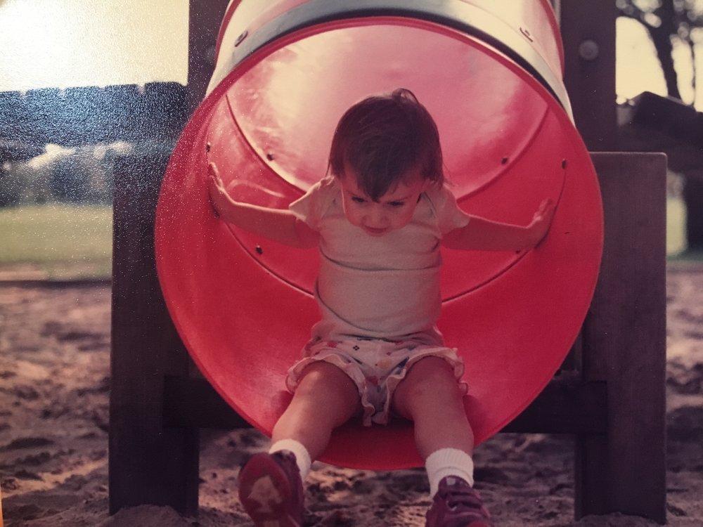 Old fashion tube slide at a park.