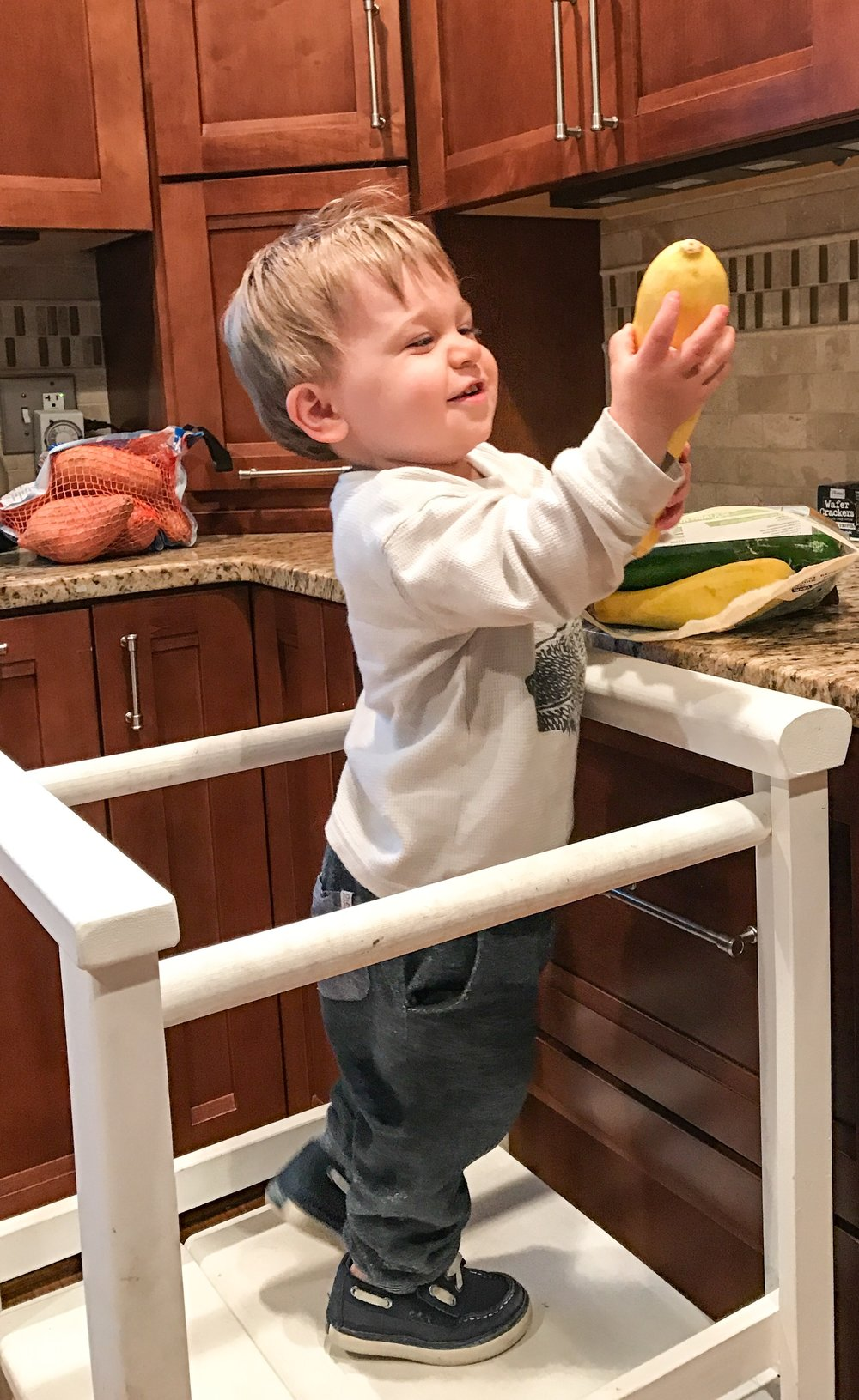 Helping mom to prep dinner while on the learning tower.