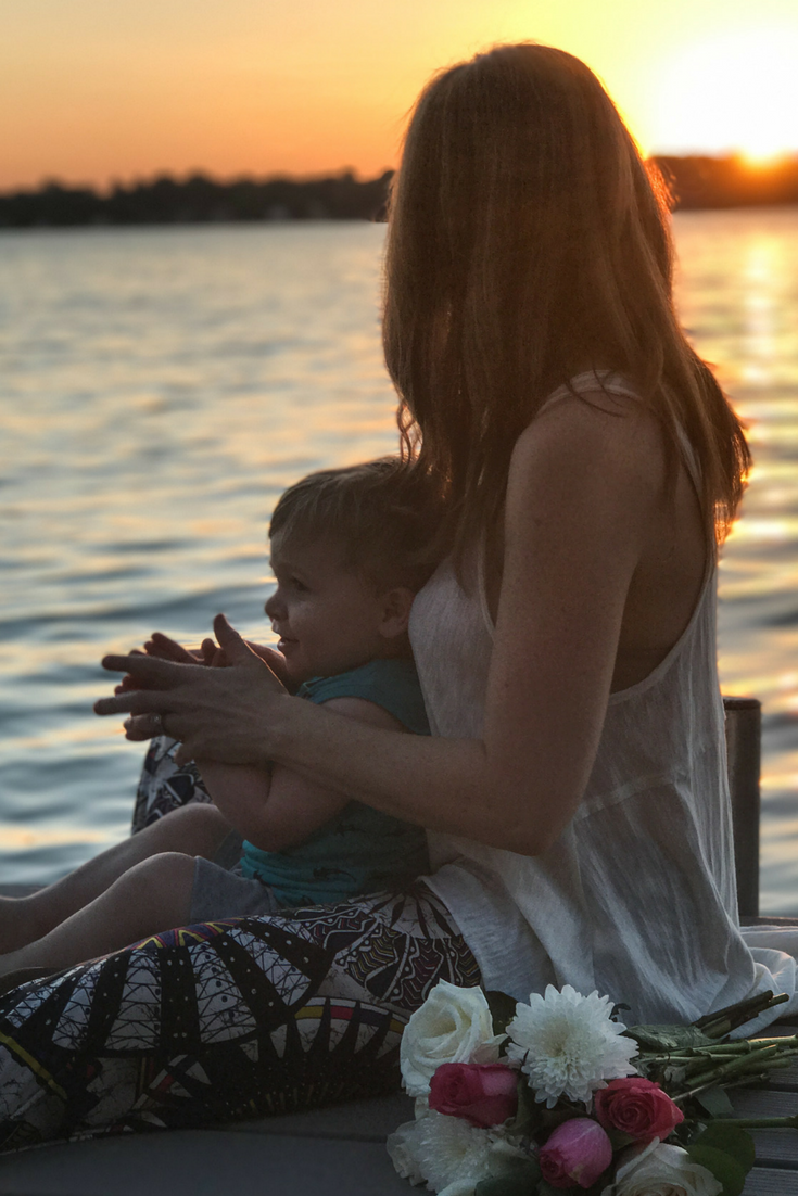 Mother and Son moment on the dock during a sunset.