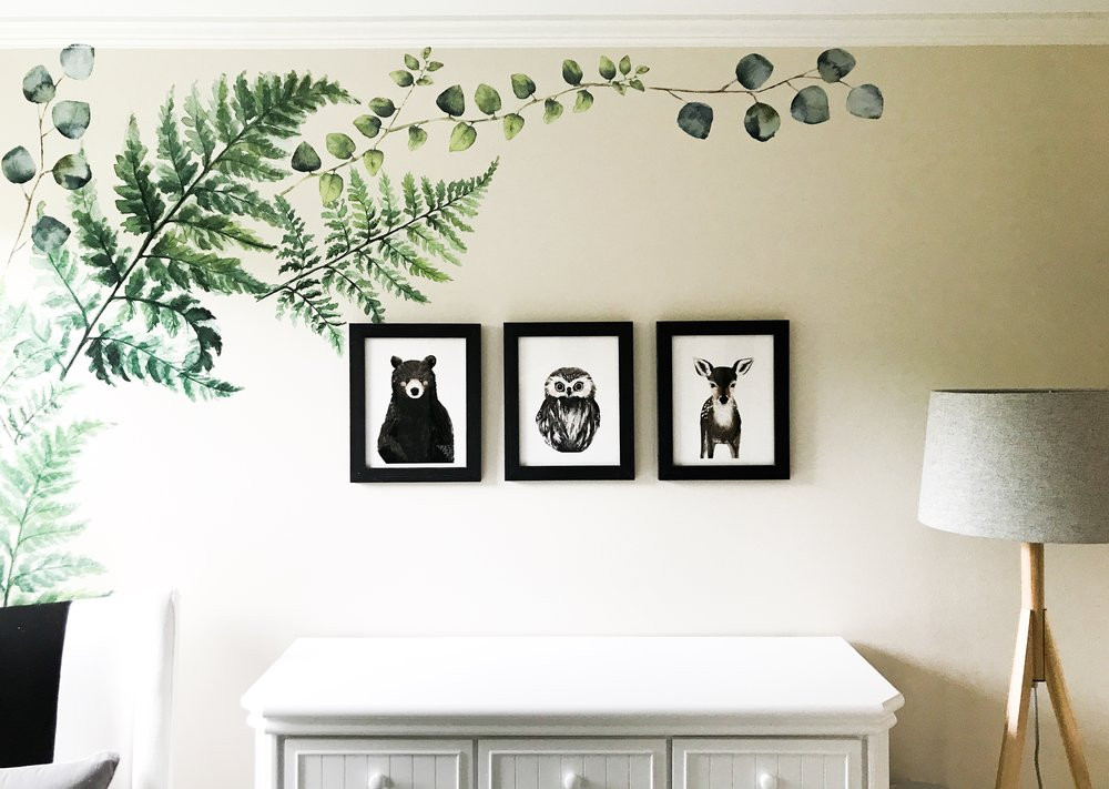 Framed Bear, Owl, and Deer Artwork. Woodland Creatures Nursery Decor For Baby Boy Or Girl. White nursery bedroom furniture. Fern wall decals to add a green pop of color to this black and white nursery.