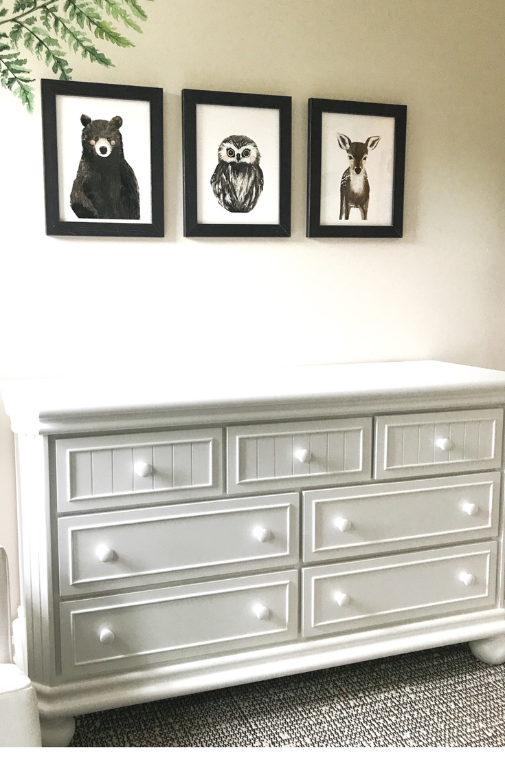 White dresser for nursery or kids bedroom. Woodland Creatures Nursery Decor For Baby Boy Or Girl. Gender neutral black and white nursery design.