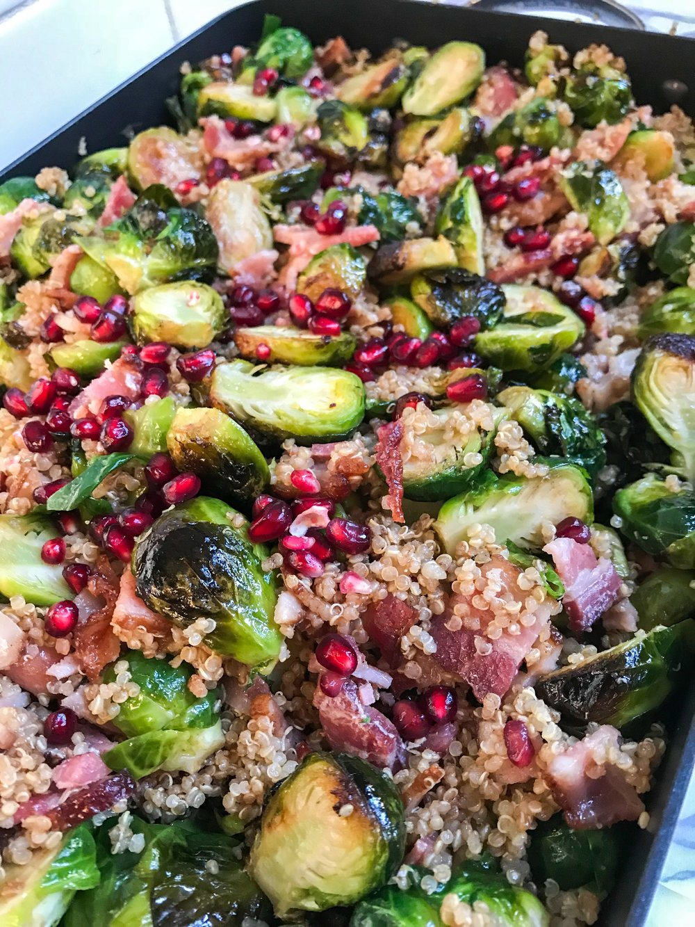 Roasted Brussel Sprouts With Bacon And Pomegranate. Best holiday recipe ideas.