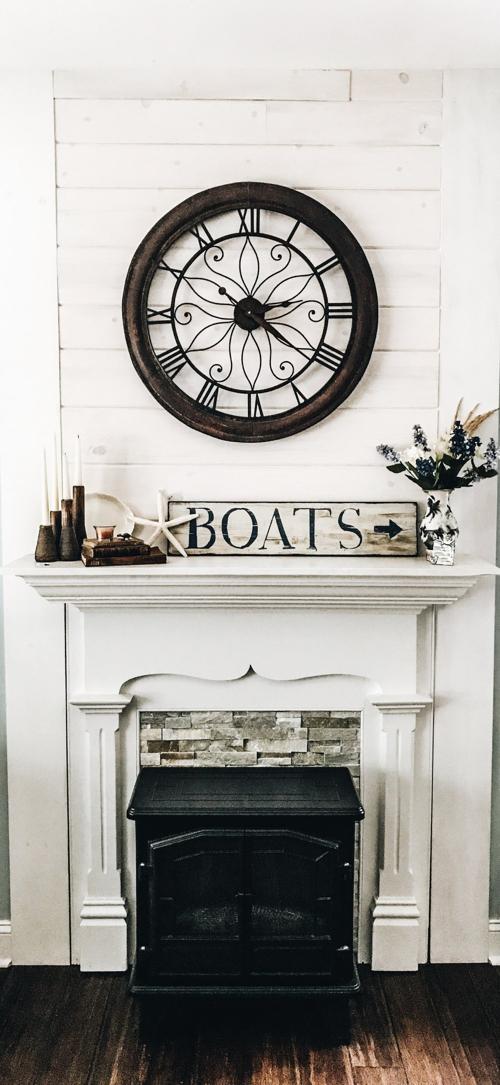 Lake House Fireplace Decor. How to decorate a fireplace. Large clock above a fireplace.