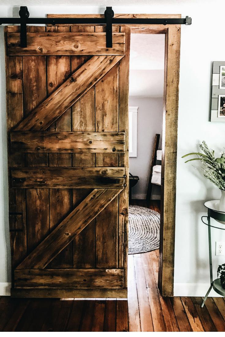 Sliding Barnwood Bathroom Door Ideas. How to get a sliding barnwood door look in your home. Authentic barnwood door in summer home.