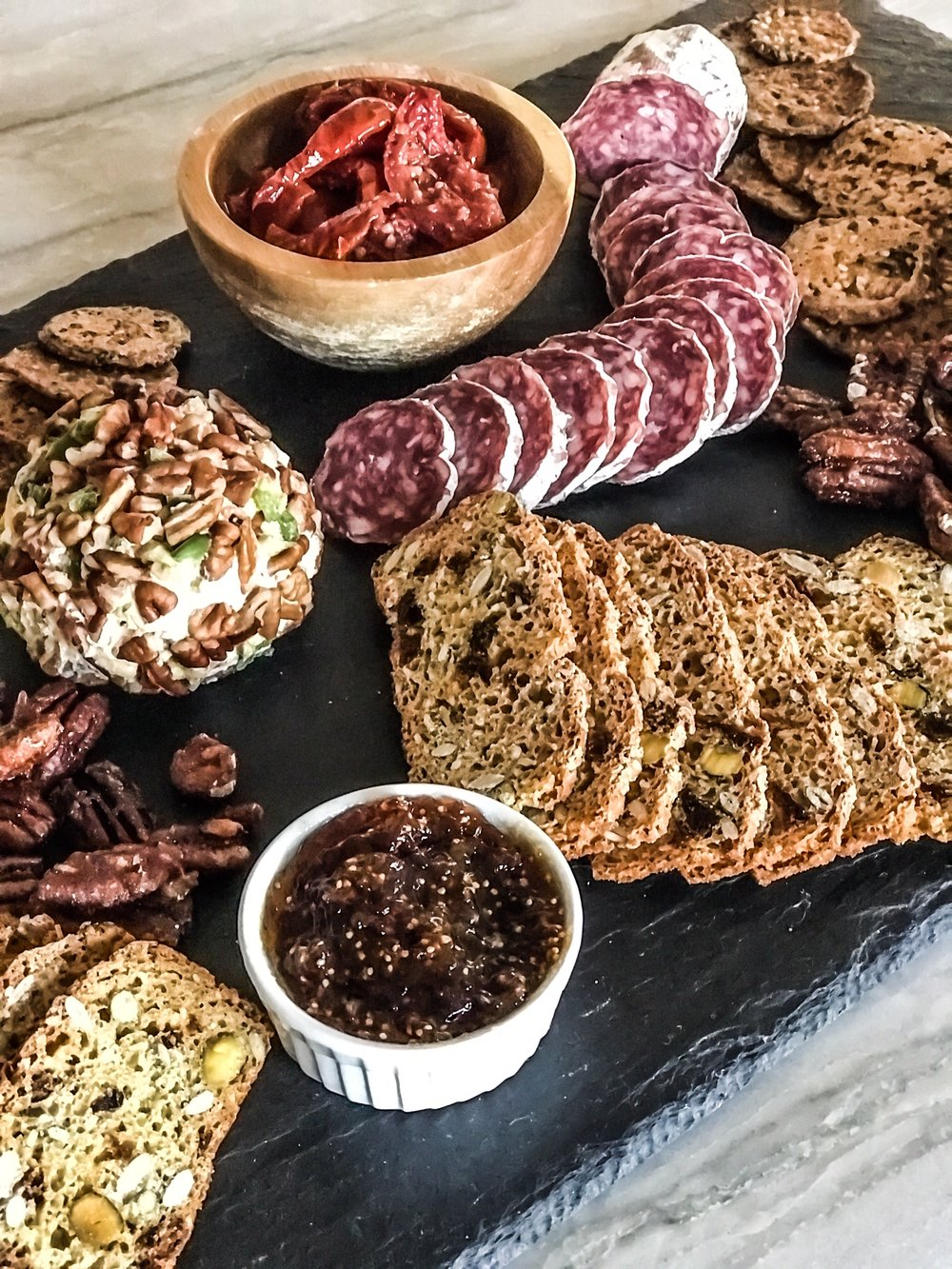 How To Create A Charcuterie Board For A New Year's Eve Party. Appetizer ideas for New Year's Eve Party. Meat And Cheese Appetizer Board. Unique products from Whole Foods Market For Your Holiday Party. #sponsored #LowKeyNYE #MakesMeWhole #Whole #Foods