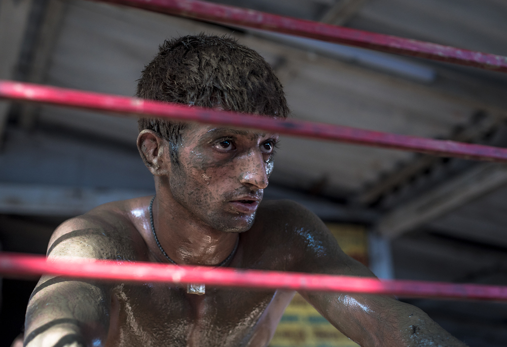 "In between workouts, Suraj Kant takes a breather and talks to me about the akhara and its future. ""There is diminishing interest in kushti and resources are scarce. We each have to consume 200 grams of almonds, half a pound of ghee (clarified butter), two to three types of vegetables and 3 litres of milk, a day. Without that fuel, our bodies cannot sustain pehlwani. We go to local schools and we also work to afford this akhara and its related expenses. There is no meaningful support from the government either. We have a few individuals who have come and joined the akhara and that helps a little, but I worry how sustainable this is. My father has run this however he could for the last 50 years, soon it will be on me. Let's see."""