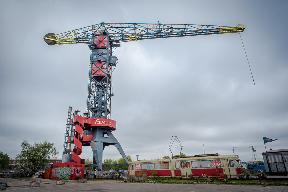 © Ayash Basu. The Faralda hotel situated in a crane. The red cubes are super high end suites, offering probably the best views of Amsterdam. A hotel with 3 rooms situated in one of the tallest cranes in Europe, amidst rail tracks and abandoned carriages.