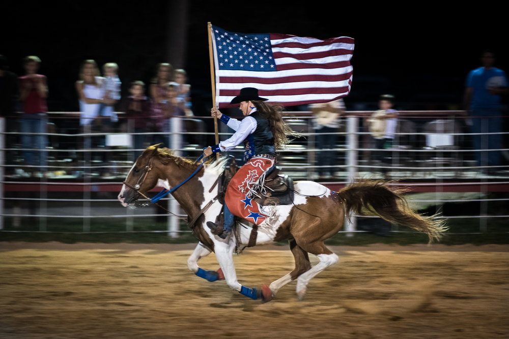 Presenting the national flag followed by the anthem at the start of every rodeo is customary etiquette. Girls, women and horses compete for these flag spots. It's a great way to stay involved with the rodeo and continue riding without the burden of competitive events. Bandera Rodeo 2017.