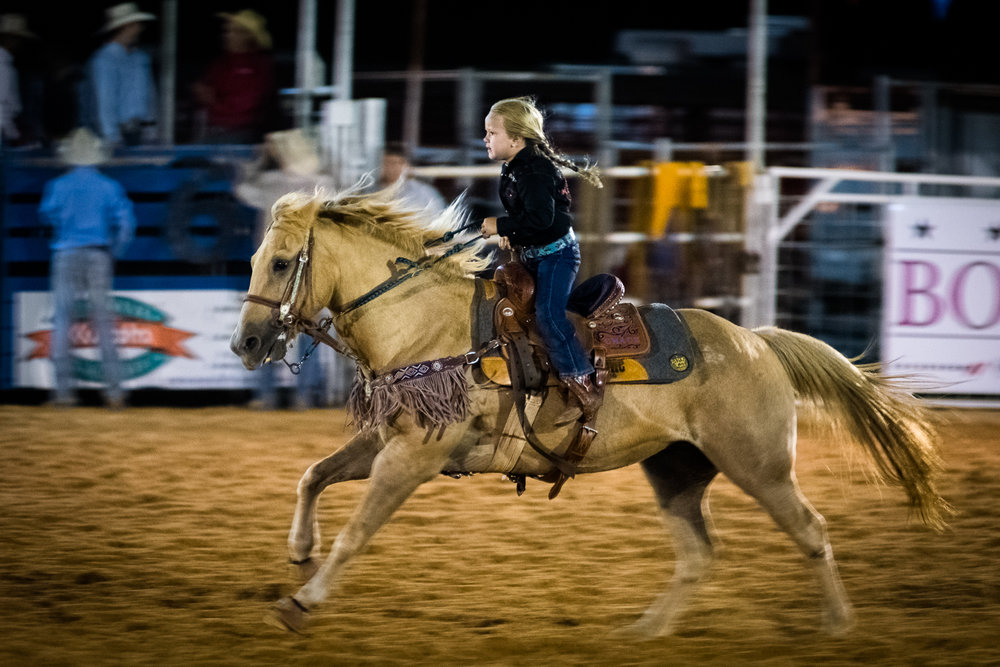 Analogous to after-school activities such as music, arts, and drama, barrel racing and horse riding are common post-school endeavors in ranches and cowboy households. Training starts early at age five and kids get a chance to showcase their progress on several rodeo nights. Boerne Rodeo 2017.