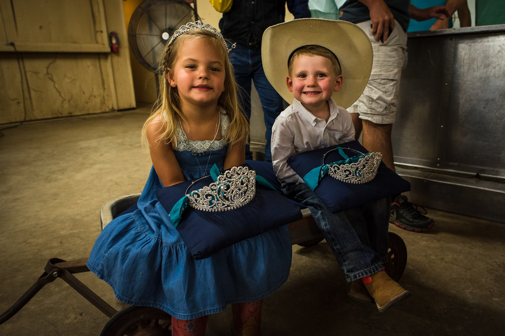 Young kids wait side-stage for the soon to be crowned Queen of Johnson City. The entire local community, including businesses, was out there to support the contestants and everyone who participated in any way, including these crown bearers. Johnson City Rodeo 2017.