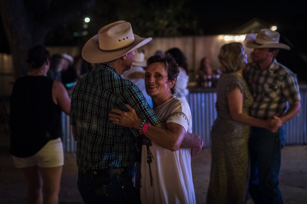 Some cowboys join the locals for the night's entertainment after a rodeo night. Saw dust covered dance floors with a live band playing country and rock-and-roll classics sets the mood for the night. 11th Street Bar, Bandera 2017.