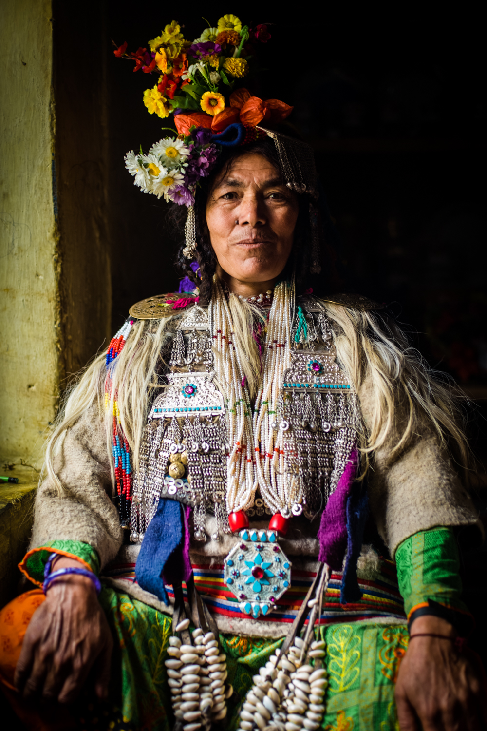 © Ayash Basu. Brokpa women adorn themselves with flowers, precious stones and silver as a mark of purity and protection against the elements.