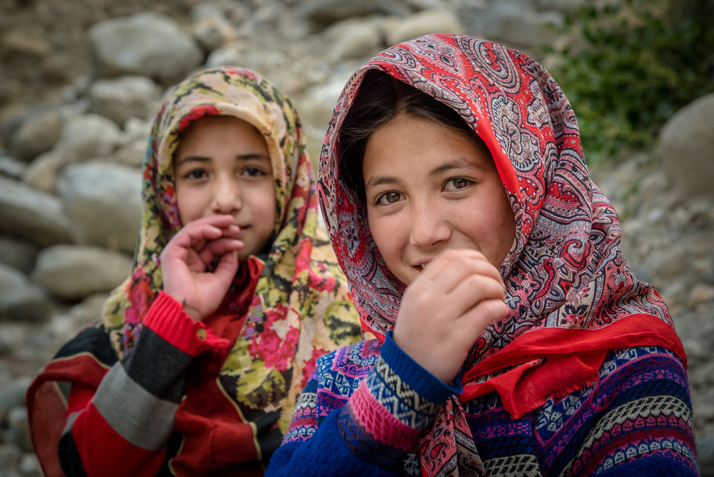 © Ayash Basu. Colorful silk scarfs adorn young women, a habit particularly seen in Balti culture. Compared to other communities in Ladakh, Balti costumes are more colorful with bold patterns.