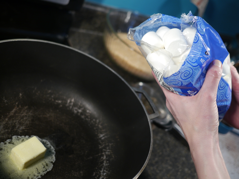 Add marshmallows to butter...