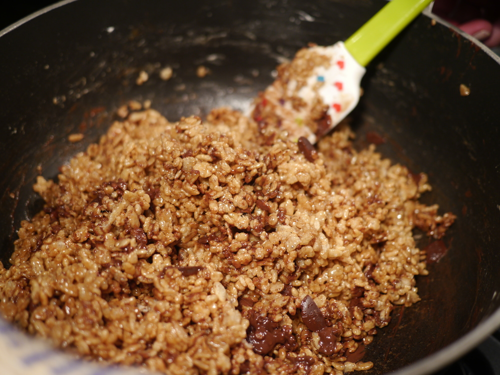 Quickly stir mixture until chocolate is evenly dispersed.