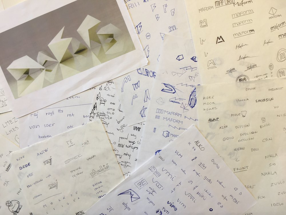 """First sketches of our name and logo. Maform is already there, and you can see the explanation of the logo in the top left corner: we designed a 3D object that can be rotated to each letter of the name """"maform""""."""