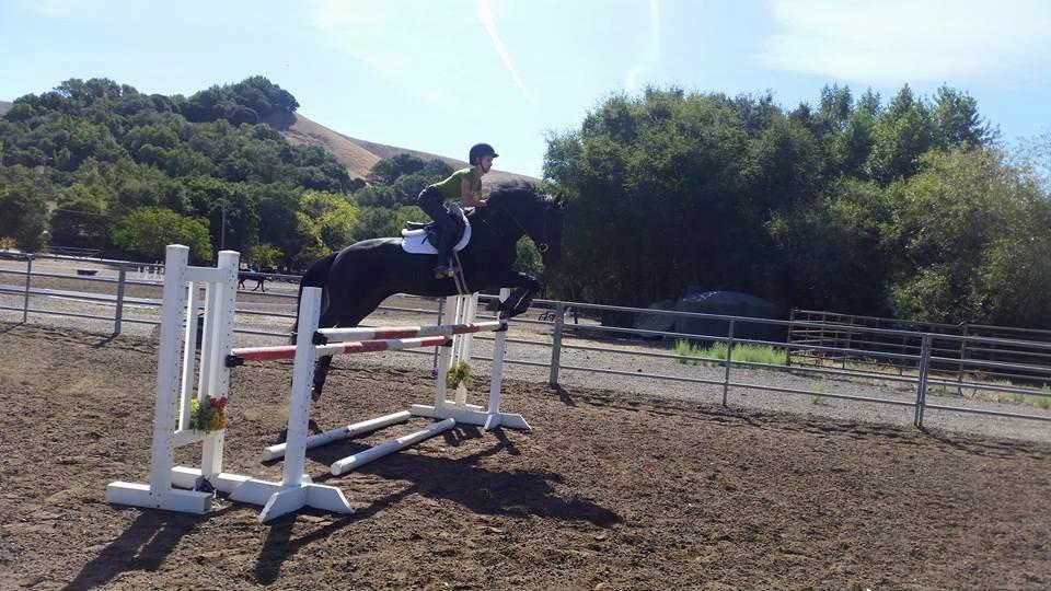Natalie&Dashari jumping.jpg
