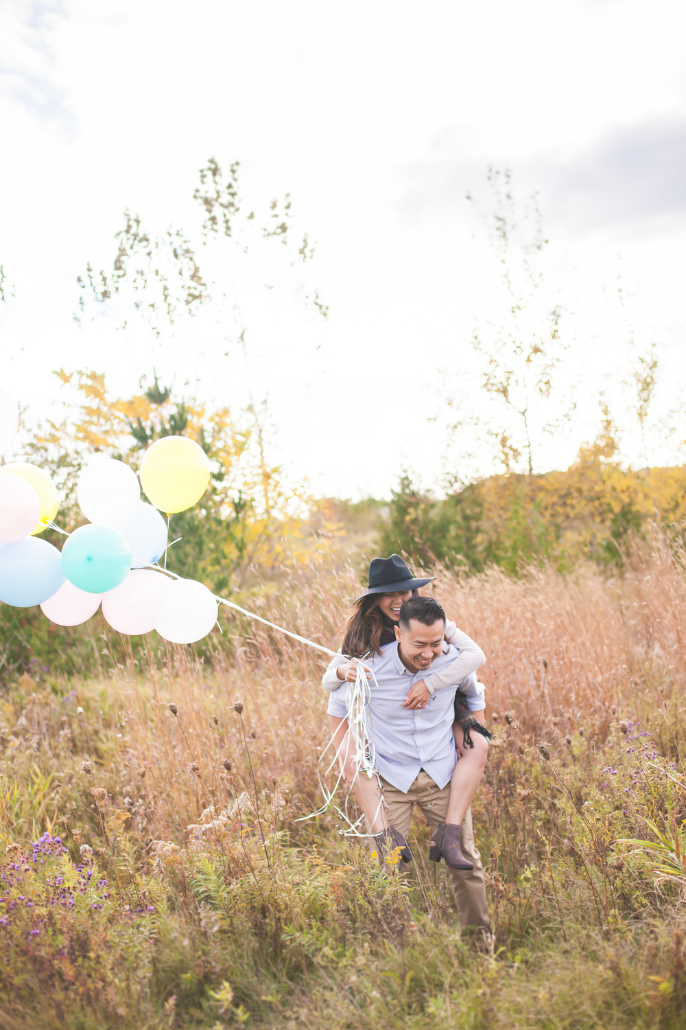 Outdoor bohemian style engagement session with balloons